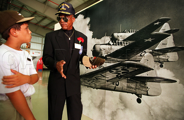 8/16/95 Al Diaz/Herald Staff--Jason Hidalgo, 11, talks with Tuskegee airman Eldridge Williams at Weeks museum after viewing the HBO drama Tuskegee Airmen. Tamiami Airport, Miami