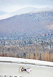 18 December 2010: Mellissa These slides through curve 14 with Whiteface Mountain in the background, finishing in 13th place for Canada at the Viessmann FIBT World Cup Bobsled Championships on Mount Van Hoevenberg in Lake Placid, New York, USA. Mandatory Credit: Ed Wolfstein Photo