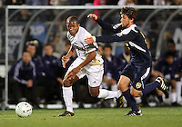 Darlington Naqbe #6 of the University of Akron tries to get away from Adam Shaw #5 of the University of Michigan during the 2010 College Cup semi-final at Harder Stadium, on December 10 2010, in Santa Barbara, California. Akron won 2-1.