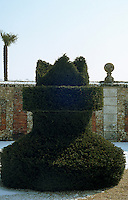 A topiary hedge clipped in the shape of a chess piece