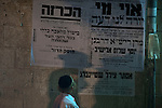 An Ultra-Orthodox Jewish kid looks at a poster notifying the passing away of Rabbi Yosef Shalom Elyashiv, during the funeral in Jerusalem. Elyashiv, revered by Jews worldwide as the top rabbinic authority of this generation for his scholarship and rulings on complex elements of Jewish law, died Wednesday, hospital officials said. He was 102.