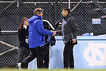 06 November 2012: Duke head coach John Kerr, Jr. (left) and UNC head coach Carlos Somoano (right) shake hands after the game. The University of North Carolina Tar Heels defeated the Duke University Blue Devils 1-0 at Fetzer Field in Chapel Hill, North Carolina in a 2012 NCAA Division I Men's Soccer game. The game was an Atlantic Coast Conference quarterfinal match.