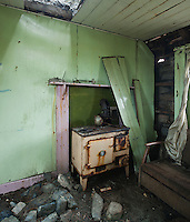 Wood burning stove in derelict croft house, Berneray, Outer Hebrides, Scotland