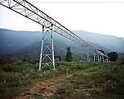 Half constructed trolley way leading to the proposed area for mining in the Niyamgiri hill is seen in Lanjigarh, Orissa. Also seen at the distance are the Niyamgiri hills.  Since the photograph was taken, the conveyor trolley belt is almost ready, Vedanta sources say the company is ready with the mining plan. Bauxite ores will be extracted from the hilltop and will be brought to the plant site through a conveyor belt.