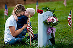 Brittany Jacobs of Hertford, NC, hugs her 17-month old son Christian at her husband, Marine SGT Christopher Jacobs' gravesite in Arlington National Cemetery on Memorial Day at in Arlington, VA, USA on 28 May, 2012.