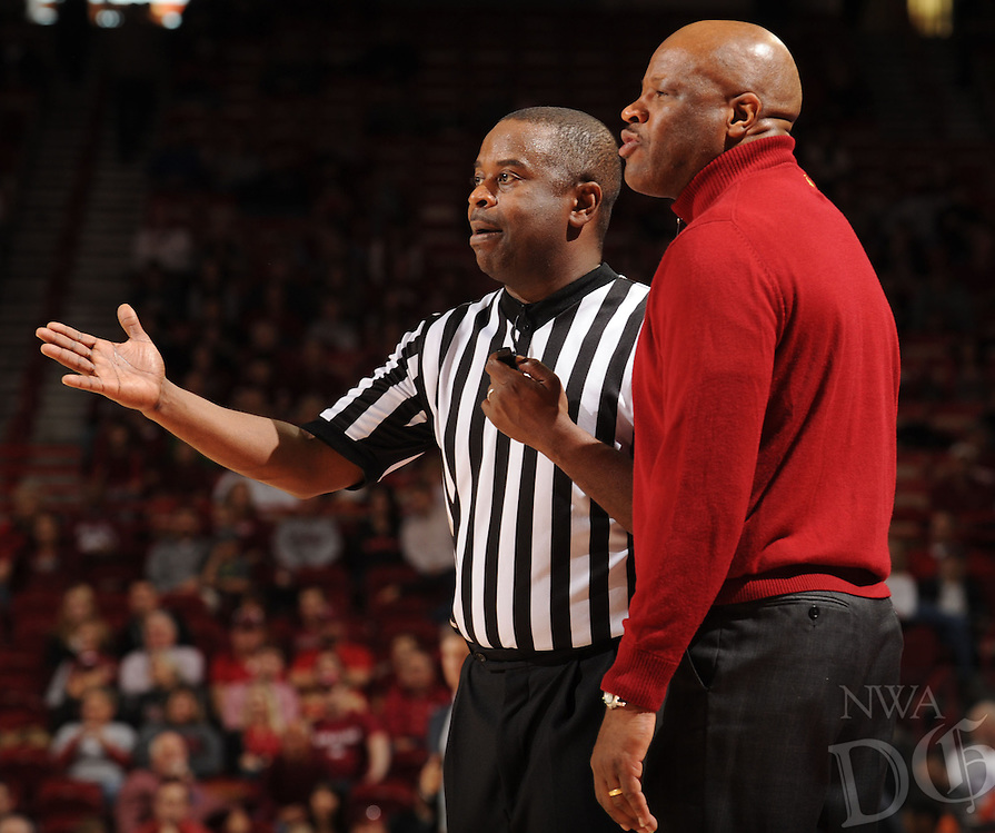 NWA Media/ANDY SHUPE - Arkansas coach Mike Anderson speaks to a game official against Northwestern State during the second half of the Razorbacks' 100-92 win Sunday, Dec. 28, 2014, in Bud Walton Arena in Fayetteville.