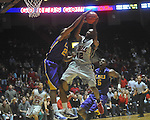 "Ole Miss guard Chris Warren (12)  has his shot blocked by Louisiana State's Ralston Turner (22) at the C.M. ""Tad"" Smith Coliseum in Oxford, Miss. on Wednesday, February 9, 2011. Ole Miss won 66-60 and is now 4-5 in the Southeastern Conference."