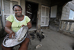 A woman grates cassava in Batey Bombita, a community in the southwest of the Dominican Republic whose population is composed of Haitian immigrants and their descendents.