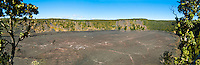 A panorama of Kilauea Iki Crater and its walking path framed by 'ohi'a trees. This crater is close to Halema'uma'u Crater.
