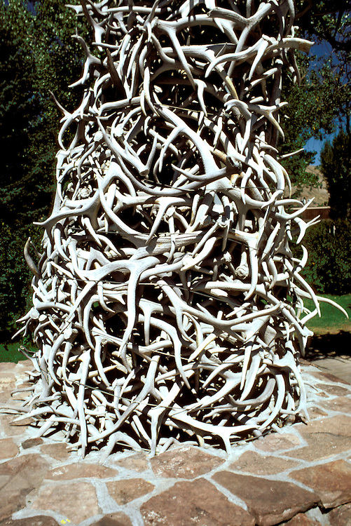 WY: Elk and deer antlers, detail of arch in Jackson Hole near Grand Teton National Park, Wyoming.Photo Copyright: Lee Foster, lee@fostertravel.com, www.fostertravel.com, (510) 549-2202.Image: wygran213