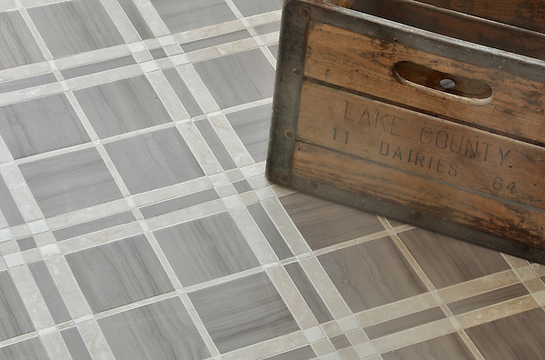 McIntyre™, a stone mosaic shown in Driftwood, Botticino, and Bianco Antico honed, is part of the Plaids and Ginghams Collection by New Ravenna Mosaics.