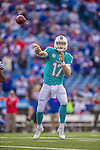 14 September 2014: Miami Dolphins quarterback Ryan Tannehill passes for short yardage in the fourth quarter against the Buffalo Bills at Ralph Wilson Stadium in Orchard Park, NY. The Bills defeated the Dolphins 29-10 to win their home opener and start the season with a 2-0 record. Mandatory Credit: Ed Wolfstein Photo *** RAW (NEF) Image File Available ***