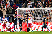 New York Red Bulls players including Markus Holgersson (5) and Heath Pearce (3) react to a missed scoring opportunity late in the second half against Sporting Kansas City. Sporting Kansas City defeated the New York Red Bulls 1-0 during a Major League Soccer (MLS) match at Red Bull Arena in Harrison, NJ, on April 17, 2013.