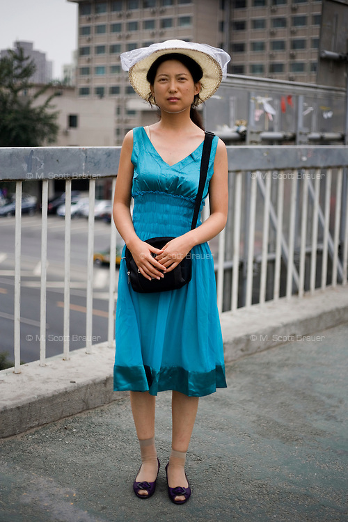 Wujunlian, a vendor, age 32, poses for a portrait in Beijing. Response to 'What does China mean to you?': 'I believe China is among the big countries.'  Response to 'What is China's role in the future?': 'China of the future will develop at the speed of light.'