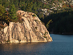 Steep rocky shore of lake George. Beautiful fall nature scenery. Killarney Provincial Park, Ontario, Canada