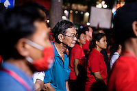 Red Shirts supporters are listening their leaders speaking at Ratchaprasong, their camp in the center of Bangkok, sunday 18 april.