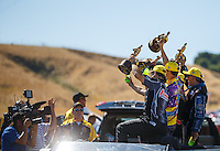 Jul 31, 2016; Sonoma, CA, USA; Media photographers and Fox Sports video cameraman film NHRA pro stock driver Greg Anderson, pro stock motorcycle rider L.E. Tonglet and funny car driver John Force as they celebrate after winning the Sonoma Nationals at Sonoma Raceway. Mandatory Credit: Mark J. Rebilas-USA TODAY Sports