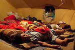DOMIZ, IRAQ: Children sleep in a tent in the Domiz refugee camp...Over 7,000 Syrian Kurds have fled the violence in Syria and are living in the Domiz refugee camp in the semi-autonomous region of Iraqi Kurdistan...Photo by Ali Arkady/Metrography