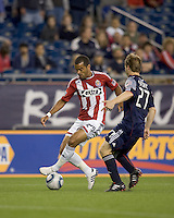 Second half substitute Chivas USA forward Maicon Santos (29) starts to dribble as New England Revolution defender Seth Sinovic (27) closes. Chivas USA defeated the New England Revolution, 4-0, at Gillette Stadium on May 5, 2010.