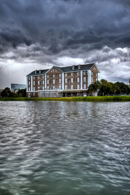 historic Rice Mill Brick building in Charleston South Carolina with Thunderclouds overhead hdr high dynamic range