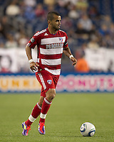 FC Dallas forward Maicon Santos (9) brings the ball forward. In a Major League Soccer (MLS) match, the New England Revolution defeated FC Dallas, 2-0, at Gillette Stadium on September 10, 2011.