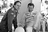 Two standout drivers in sportscar racing during the 1970s and 1980s, Al Holbert (left) and Hurley Haywood wait for the start of practice in 1982..