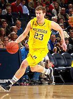 CHARLOTTESVILLE, VA- NOVEMBER 29: Evan Smotrycz #23 of the Michigan Wolverines handles the ball during the game on November 29, 2011 at the John Paul Jones Arena in Charlottesville, Virginia. Virginia defeated Michigan 70-58. (Photo by Andrew Shurtleff/Getty Images) *** Local Caption *** Evan Smotrycz