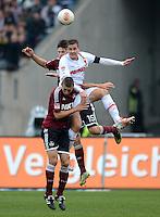 FUSSBALL   1. BUNDESLIGA  SAISON 2012/2013   8. Spieltag 1. FC Nuernberg - FC Augsburg       21.10.2012 Timmy Simons (li, 1 FC Nuernberg) GEGEN Torsten Oehrl (Mitte, FC Augsburg) GEGEN Timm Klose (1 FC Nuernberg)