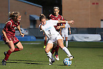 03 November 2013: North Carolina's Kealia Ohai (7) is defended by Boston College's Kate McCarthy (left) and Coco Woeltz (behind). The University of North Carolina Tar Heels hosted the Boston College Eagles at Fetzer Field in Chapel Hill, NC in a 2013 NCAA Division I Women's Soccer match and the quarterfinals of the Atlantic Coast Conference tournament. North Carolina won the game 1-0.