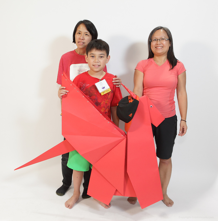 The oversized folding event. Team Philly Fire Dragons fold Wen's Dragon by Sok Song. Team members (left to right): Thu Tran, Khai Feldman, Margaret Wong