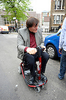 RICHARD KIEL.Having a Bond reunion lunch at The Ivy Club this afternoon, London, England..April 26th, 2010.full length grey gray suit jacket red top black trousers sitting wheelchair jaws .CAP/DYL.©Dylan/Capital Pictures.