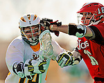 19 March 2011: University of Vermont Catamount Midfielder Thomas Galvin, a Sophomore from Cockeysville, MD, is checked by Defender Mike Sherry, a Senior from Oceanside, NY, during game action against the St. John's University Red Storm at Moulton Winder Field in Burlington, Vermont. The Catamounts defeated the visiting Red Storm 14-9. Mandatory Credit: Ed Wolfstein Photo
