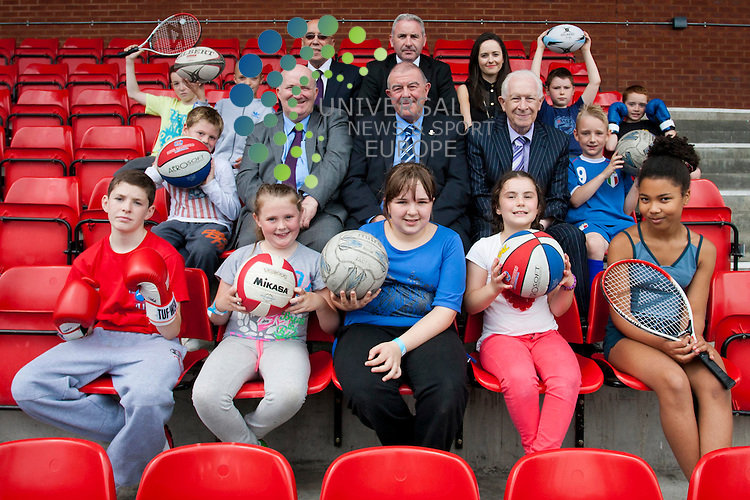 A Commonwealth Games Legacy project was unveiled in North Glasgow today. The Depute Leader of Glasgow City Council  and the Executive Member for the Commonwealth Games, Councilor Archie Graham (in picture: middle row, centre) joins members of the Rob Roy Amateur Boxing Club to unveil details of a new Commonwealth Games Legacy Project in North Glasgow. Petershill Glasgow Club, Glasgow. 5th July 2012. Picture: Jonathan Faulds / Universal News And Sport (Europe)