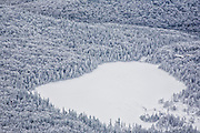 Franconia Notch State Park - Lonesome Lake from Hi-Cannon Trail during the winter months. This trail leads to the summit of Cannon Mountain in the White Mountains, New Hampshire USA.