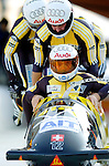 20 November 2005: Ivo Rueegg leads the Switzerland 2 sled pushoff in the first run of the 2005 FIBT AIT World Cup Men's 4-Man Bobsleigh Tour, piloting the team to an 8th place finish at the Verizon Sports Complex, in Lake Placid, NY. Mandatory Photo Credit: Ed Wolfstein.