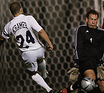 NC State goalkeeper Jorge Gonzalez (1) makes a save on Duke's Danny Kramer (24) on Friday, October 21st, 2005 at Koskinen Stadium in Durham, North Carolina. The Duke University Blue Devils defeated the North Carolina State University Wolfpack 6-0 during an NCAA Division I Men's Soccer game.