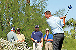 USA, Arizona, Fountain Hills.  Group of male golfers watch tee off.