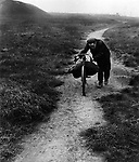 Coal miner returning home from the pit 1937