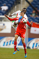 7 June 2011: Guadeloupe midfielder Jean-Luc Lambourde (13) and Panama forward Blias Pérez (7) go for the ball during the CONCACAF soccer match between Panama and Guadeloupe at Ford Field Detroit, Michigan.