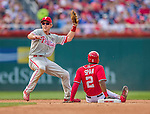 6 September 2014: Philadelphia Phillies second baseman Chase Utley gets a sliding Denard Span out attempting to steal second during play against the Washington Nationals at Nationals Park in Washington, DC. The Nationals fell to the Phillies 3-1 in the second game of their 3-game series. Mandatory Credit: Ed Wolfstein Photo *** RAW (NEF) Image File Available ***