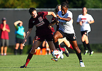 WINSTON-SALEM, NORTH CAROLINA - August 30, 2013:<br />  Christine Exeter (22) of Louisville University battles past a tackle from Jordan Coburn (19) of Virginia Tech during a match at the Wake Forest Invitational tournament at Wake Forest University on August 30. The game ended in a 1-1 tie.