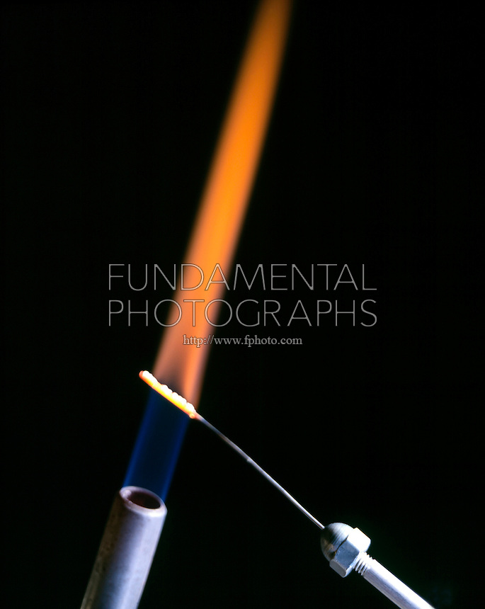 CALCIUM FLAME TEST<br /> (Variations Available)<br /> Orange-red flame<br /> (Alkaline earth metal) <br /> Calcium compound is dissociated by flame into gaseous atoms, not ions. Atoms of the element are raised to excited state by high temperature of flame. Excess energy from the atom is emitted as light of a characteristic wavelength.