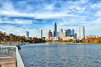 This is an another image on Ladybird Lake hike and bike trail with the Austin Skyline in the background.  This day was  a beautiful fall day in December along the boardwalk the wonderful cityscape of downtown Austtin in the background. Austin has a very unique and modern skyline with many high rise skyscrapers along the river of this up and coming city.  Austin population is changing daily but the last count I heard was somewhere between 800,000 and 900,00 people with more moving in daily.