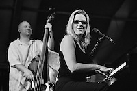 Diana Krall with bassist Ben Wolfe performing on the WWOZ stage in the Jazz Tent at the 2000 New Orleans Jazz and Heritage Festival in New Orleans, Louisiana. USA. Camera: Leica R8 / Lens: 180mm f/2.8 Elmarit-R / Film: Illford HP5 400