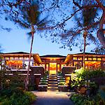The Four Seasons Resort Hualalai at Historic Kaupulehu on the Big Island of Hawaii. The main lobby building at dusk and sunrise.