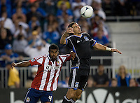 Alan Gordon of Earthquakes controls the ball in the air away from Rauwshan McKenzie of Chivas USA during the second half of the game at Buck Shaw Stadium in Santa Clara, California on September 2nd, 2012.   San Jose Earthquakes defeated Chivas USA, 4-0.