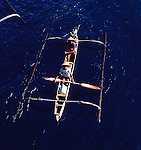 Two men in outrigger canoe, Bali Indonesia.