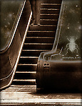 A figure on an escalator