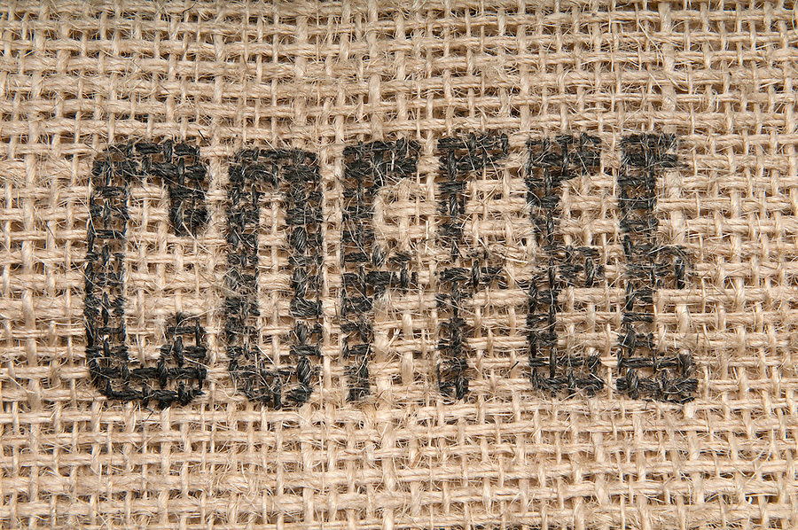 Burlap with coffee inscription for use as background or texture.
