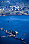 The damaged Sea Empress in dock having grounded and leaked a  72,000 tonne oil spill.  Milford Haven refinery in the background.<br /> Pembrokeshire 1996